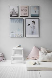an organised bedroom, with tidy pictures on the wall
