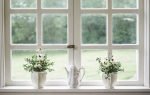 a window sill with a few household items, clean and bright
