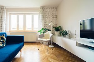 a bright living room with no mess, just plants, seats and sofas